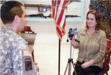 Sergeant First Class Dean Baratta being interviewed by Carol Fowler of the New Jersey Militia Museum